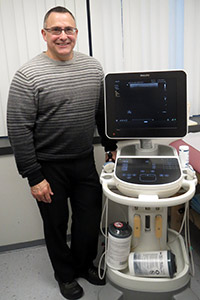 Dr. Andersen with Ultrasound Machine